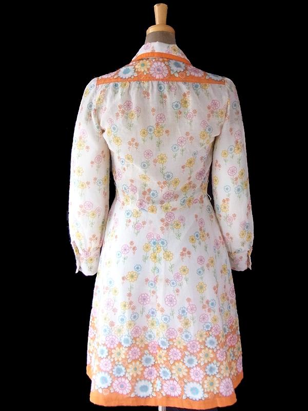 ヨーロッパ古着 ロンドン買い付け 60年代製 ホワイト X カラフル花柄イラスト オレンジのテープ縁取りワンピース 16OM818